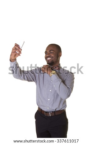 A young man or teenager taking a photo of himself with his cell phone isolated on white - stock photo