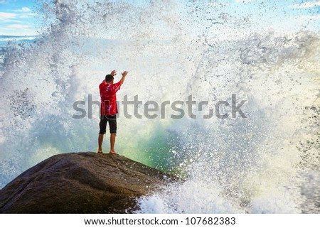 A young man prays sea elements - stock photo