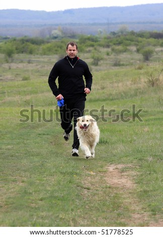 A young man running with your dog - stock photo