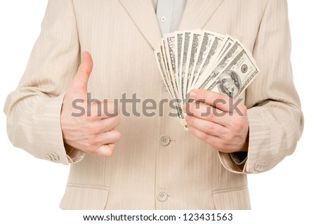 a young man shows that he has is there are us dollars isolated on white background - stock photo