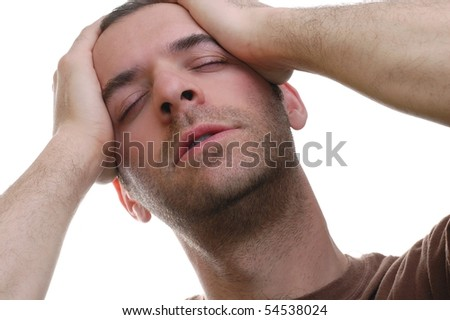 A Young Man Suffering with a Headache - stock photo