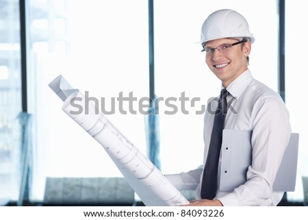 A young man with a project on building - stock photo