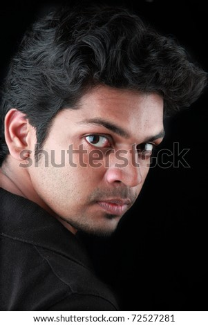 A young man with a sharp look - stock photo