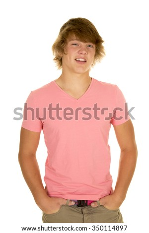 A young man with a smile, in his pink top looking good. - stock photo