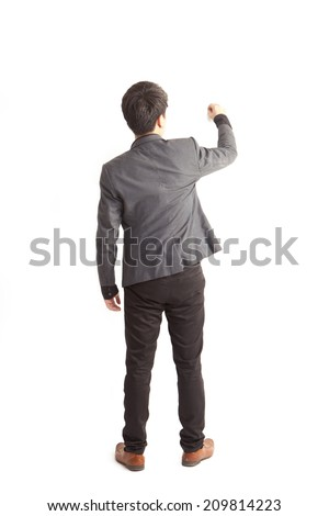A young man with his back turned to camera, drawing something - stock photo