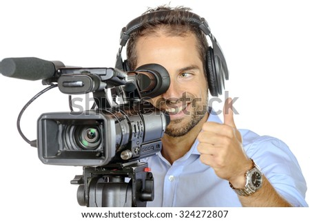 a young man with professional movie camera on white background - stock photo