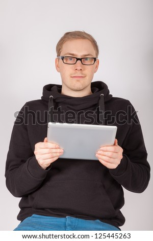 A young man working with a tablet PC - stock photo