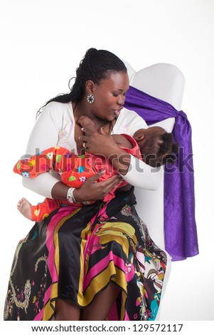 A young mother playing with her new born little girl. - stock photo