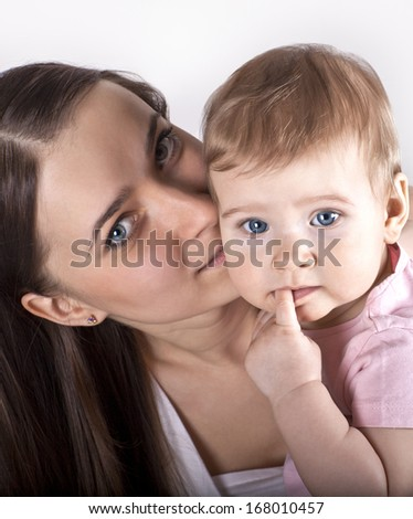A young mother with a baby - stock photo