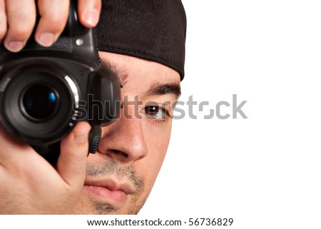 A young photographer taking a photo with his digital single lens reflex camera - stock photo
