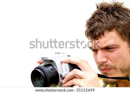 A young photographer with a camera - stock photo