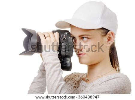 a young photographer woman with white cap isolated on white - stock photo