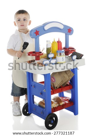 A young preschooler tending his hot dog stand.  The stand's signs are left blank for your text.  On a white background. - stock photo