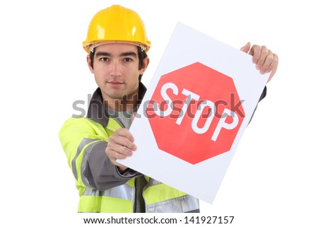 A young road worker. - stock photo