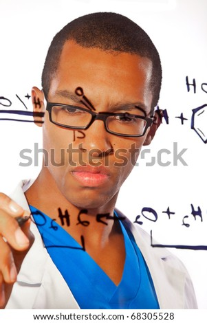 A young scientist works on a chemistry equation - stock photo