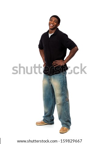 A young smiling casually dressed African American male standing on a white background - stock photo