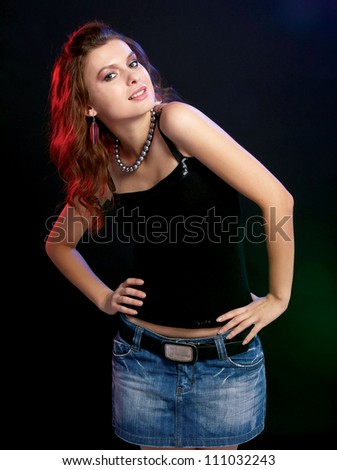 A young stylish girl, isolated on black background - stock photo