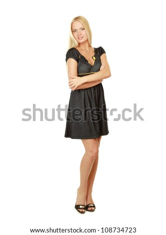 A young stylish girl standing with folded arms, isolated on white background - stock photo
