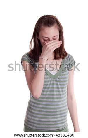 a  young teenage girl with her hand covering her face - stock photo