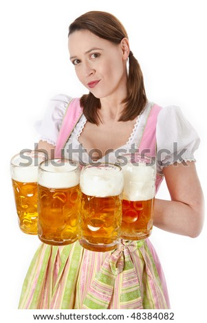 A young waitress serving many beers Oktoberfest style - stock photo