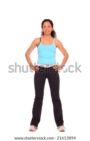 A young woman doing some exercises over white background - stock photo