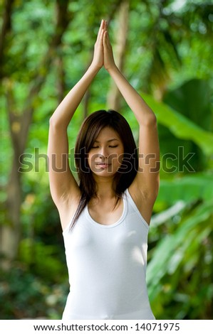 A young woman doing yoga outside - stock photo