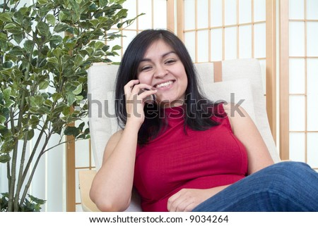 A young woman enjoying a pleasant cell phone conversation. - stock photo