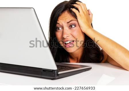 a young woman has trouble with her laptop computer. symbol photo for data crash, spam and computer viruses - stock photo