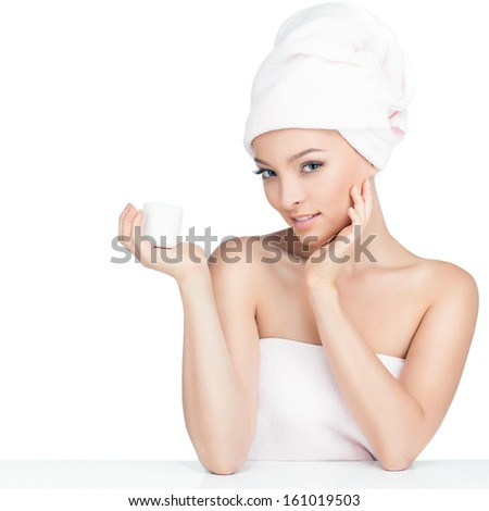 A young woman holds a jar of cream. - stock photo