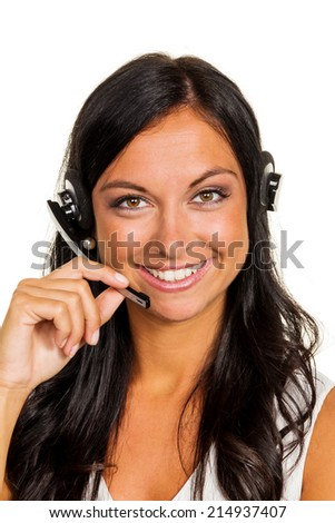 a young woman in a customer service center phone with customer with a headset - stock photo