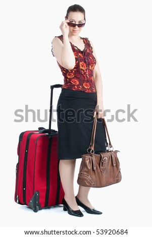 A young woman in a travel scenario with luggage and sunglasses on white. - stock photo