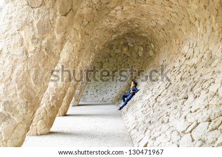 A young woman in Guell park in Barcelona - stock photo