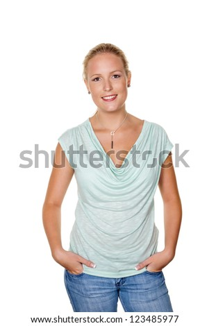 a young woman in jeans standing in front of a white background - stock photo