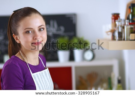 A young woman in the kitchen. - stock photo