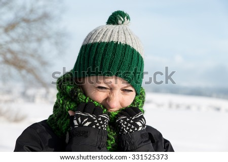 a young woman is freezing on the walk  - stock photo