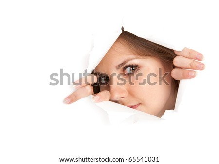 a young woman is looking through a window is made from paper. isolated on white background - stock photo