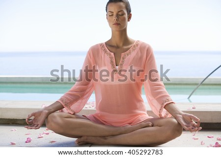 A young woman practicing yoga - stock photo