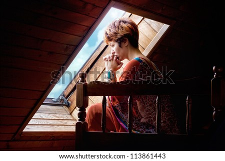 A young woman praying. - stock photo