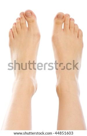 A young woman 's feet closeup, isolated on white. - stock photo