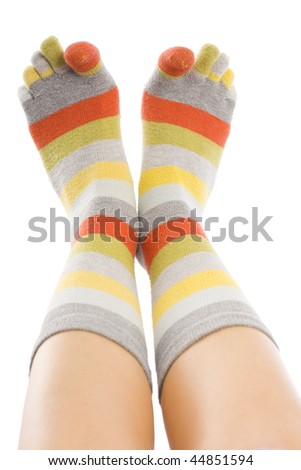 A young woman 's feet wearing closeup, isolated on white. - stock photo