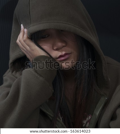 A young woman sad and depressed - stock photo