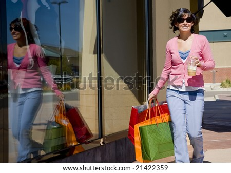 A young woman shopping holding bags - stock photo