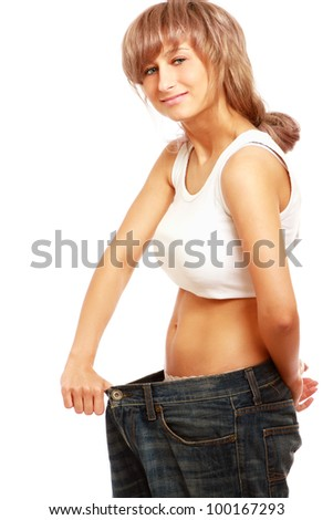 A young woman showing how much she lost, isolated on white background - stock photo