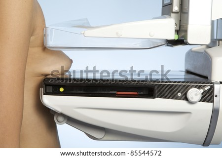 A young woman taking a mammogram x-ray test - stock photo