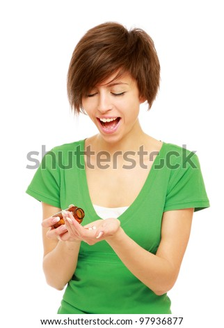A young woman taking pills , isolated on white background - stock photo