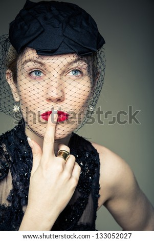 A young woman trying to make a decision - stock photo