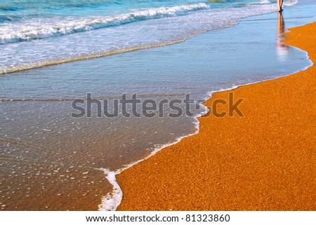 A young woman walking on the sea - stock photo