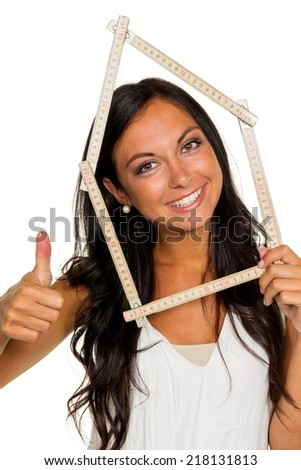 a young woman wants to build a house - stock photo