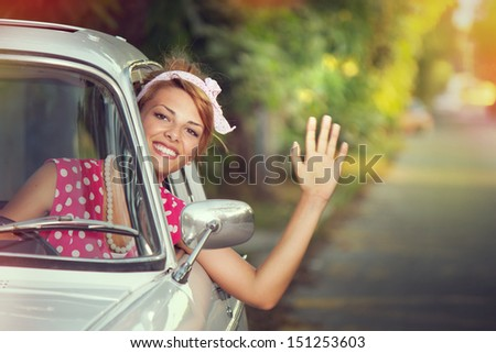 A young woman waving and goes on a holiday - stock photo