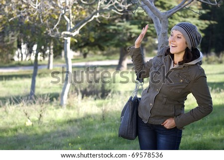 a young woman waving his hand - stock photo